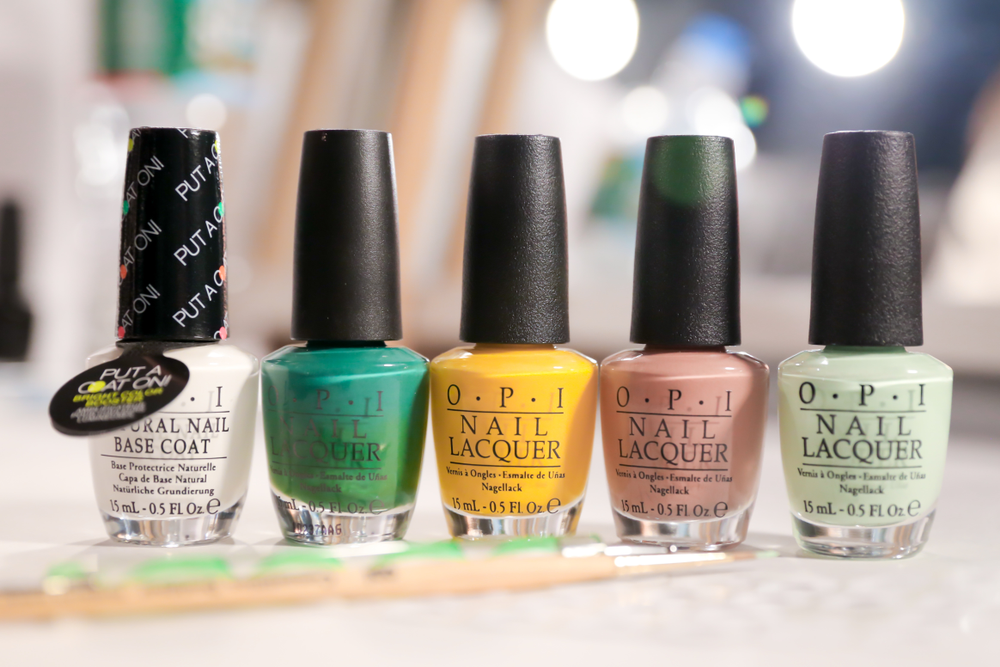 <p>To create the daisy on the toes at Charlotte Ronson, the following shades were used: Put a Coat On It! (petals), Jade is the New Black (stem), and Barefoot in Barcelona layered with Need Sunglasses? (flower center).&nbsp;Photo courtesy of OPI.&nbsp;</p>