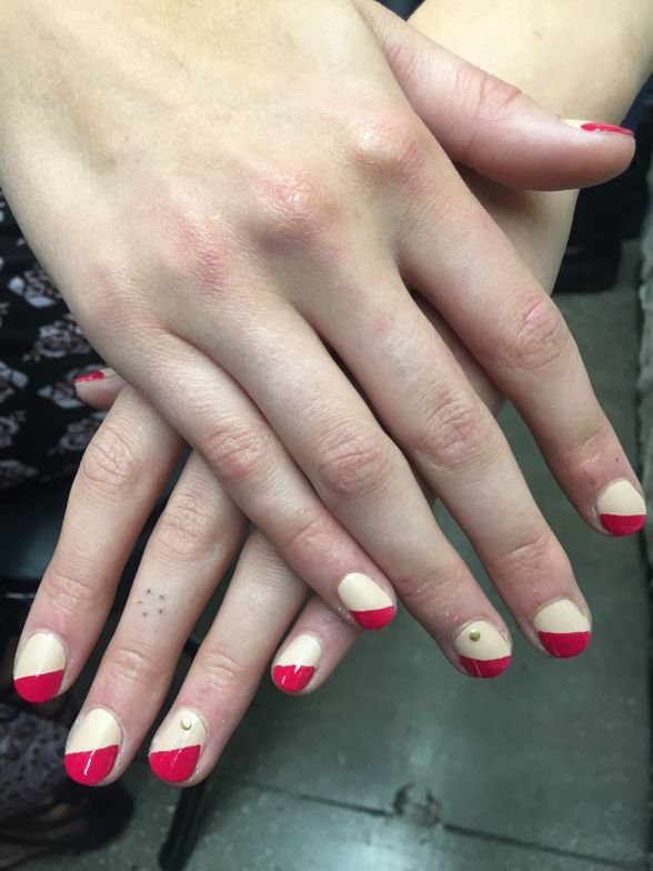 <p>Leonabi Galvez for OPI used Pale to the Chief, Matte Top Coat, and Madam President on a diagonal at Helen Castillo. Rhinestones were added to the ring fingers for extra shine.</p>