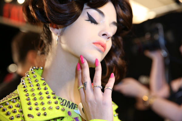 <p>Nails at Jeremy Scott were accented with a pop art cartoon flare on the pinkys in OPI Alpine Snow.</p>