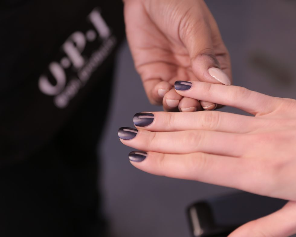 <p>A matte nail look with a strip of negative space gave a bold and strong feminine touch to nails at OPI for Marissa Webb.</p>