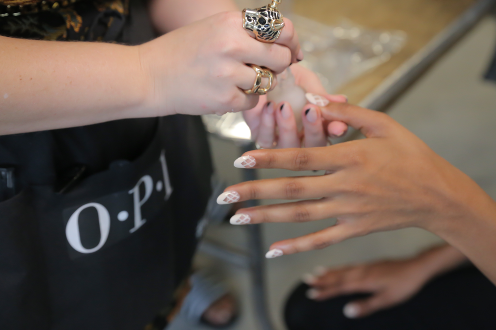 <p>Lead nail artist Miss Pop created a nail look featuring a unique knit design with a chevron tip on a classic, oval-shaped nail for Azede Jean-Pierre.&nbsp;Photo courtesy of OPI.&nbsp;</p>