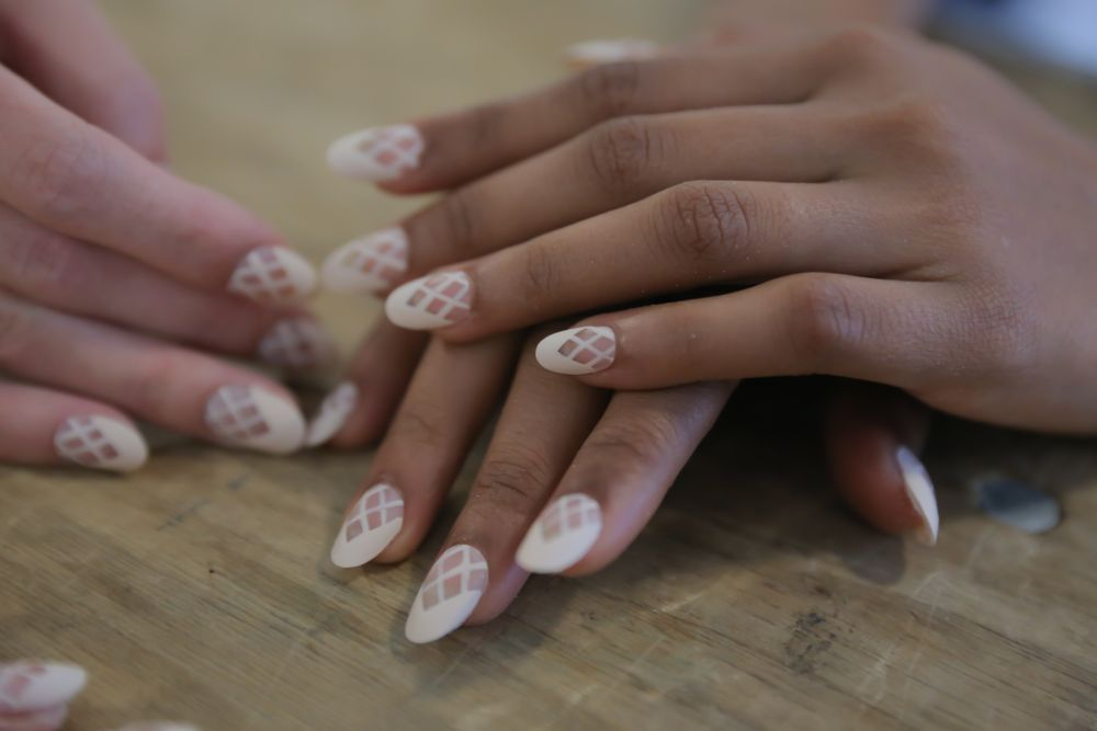 """<p style=""""margin: 0in; margin-bottom: .0001pt;""""><span style=""""font-size: 10.0pt; font-family: 'Verdana','sans-serif';"""">The latticed&nbsp;French manicure at Azede Jean-Pierre featured&nbsp;negative space and was&nbsp;finished&nbsp;with Matte Top Coat. Photo courtesy of OPI.&nbsp;&nbsp;</span></p>"""
