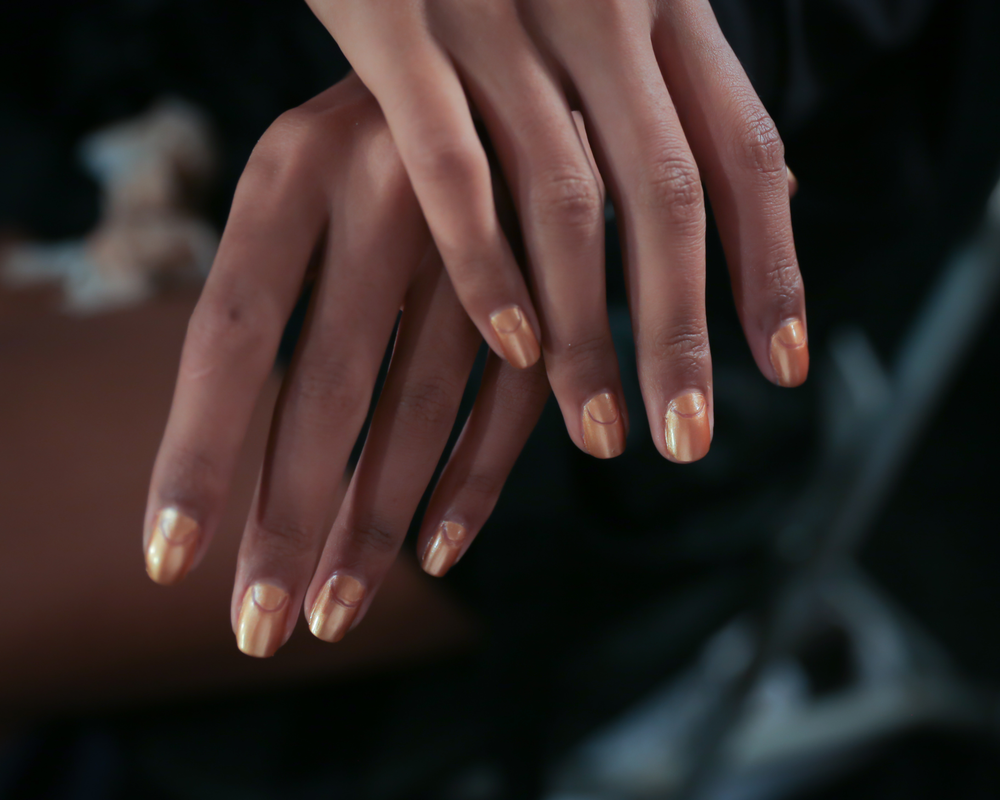 <p>Two coats of OPI with a Nice Finn-ish was applied to models&rsquo; nails and a half moon cutout was created using a medium-sized dotting tool at Clover Canyon. Photo courtesy of OPI.&nbsp;&nbsp;&nbsp;</p>