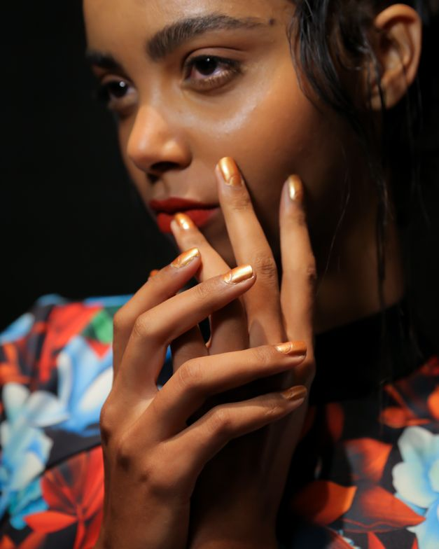 <p>Base Coat was used to prep nails and Top Coat to seal the look. Cuticle Oil to Go was used on all models to hydrate tired cuticles.&nbsp;Photo courtesy of OPI.</p>