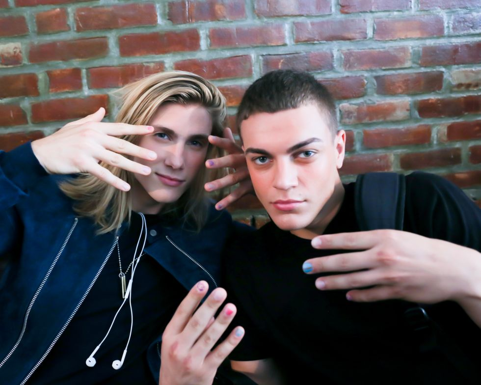 <p>New to the runways, the playful nail art was carried through to the male models. Several of the male models also featured one of more of the bright, paint-inspired nails. &ldquo;The next step for polish is getting it on men, including nail art,&rdquo; says Miss Pop.&nbsp;Photo courtesy of OPI.</p>