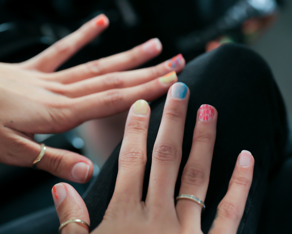 <p>Every model&rsquo;s hand featured a different set of designs, mixing multicolor nails and individual bright hues partially or fully painted on with the airbrush-like technique, while some nails were left in the new nude &ndash; Matte Top Coat.&nbsp;Photo courtesy of OPI.</p>