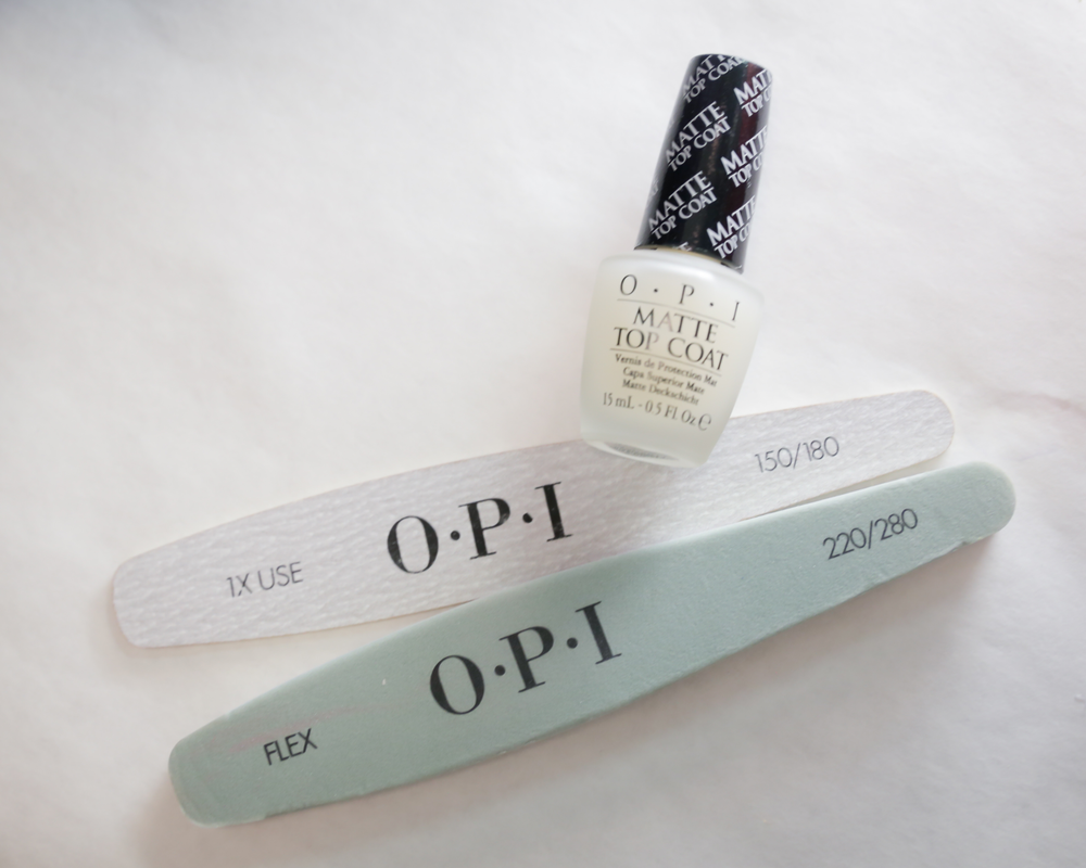 <p>Lead nail artist Miss Pop created a natural, minimalist manicure for J. Mendel using Matte Top Coat on a clean, lightly filed nail.&nbsp;Photo courtesy of OPI.&nbsp;</p>