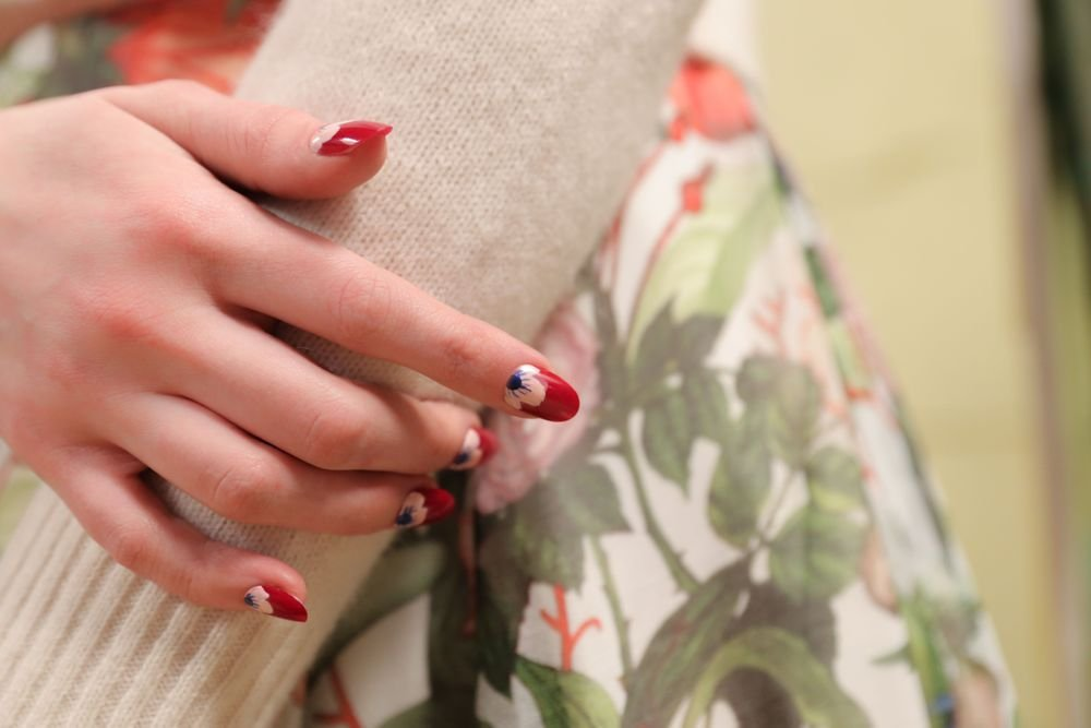<p>OPI Malaga Wine, Alpine Snow, Hopelessly in Love, and Blue My Mind completed the floral nail art at Rachel Antonoff.</p>