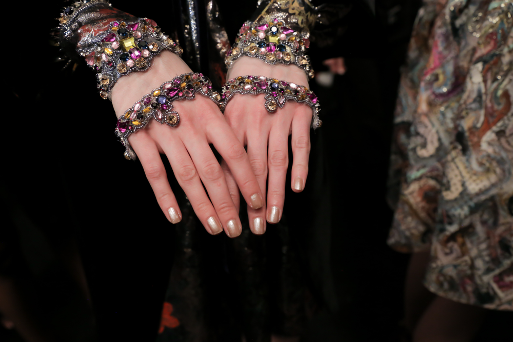 <p>Reem Acra showed champagne colored gowns, so OPI mixed a custom blend of shimmery gold for nails.</p>