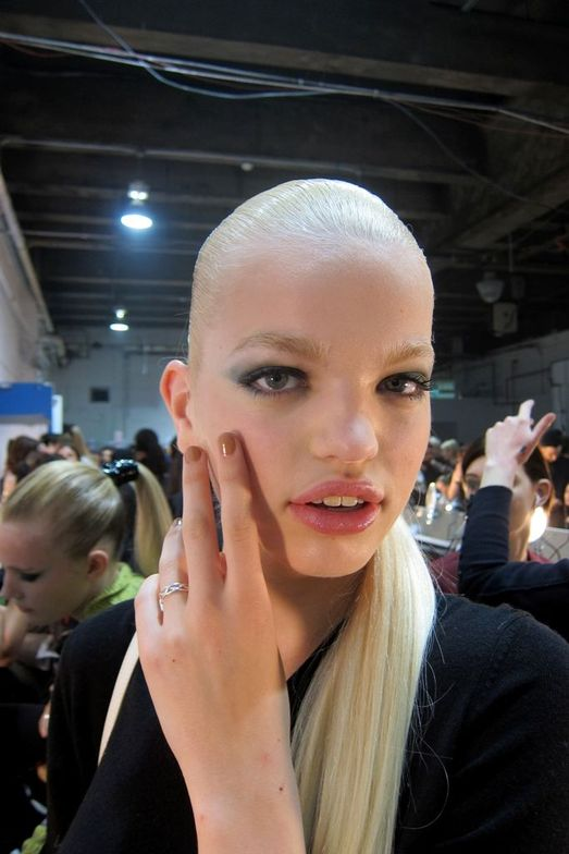 """<p class=""""TDP"""">For Jason Wu, models&rsquo; nails were painted with a taupe hue, <strong>OPI</strong> San Tan-tonio, which complemented clothes in taupe, black, and gold with pops of fuchsia and red. <em>Photo courtesy of OPI</em></p>"""