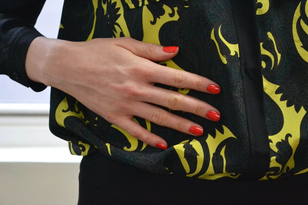 <p>BOLD COLOR: Bright coral red OPI MonSooner or Later added a bold pop of color to the collection's mix of dark camel, black, nude, emerald and gold. Photo courtesy of OPI</p>