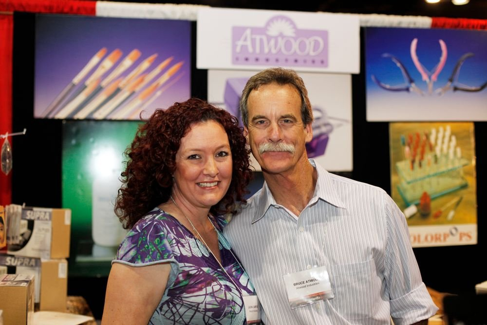 <p>Laura Campos and Bruce Atwood from Atwood Industries pose for a photo.</p>