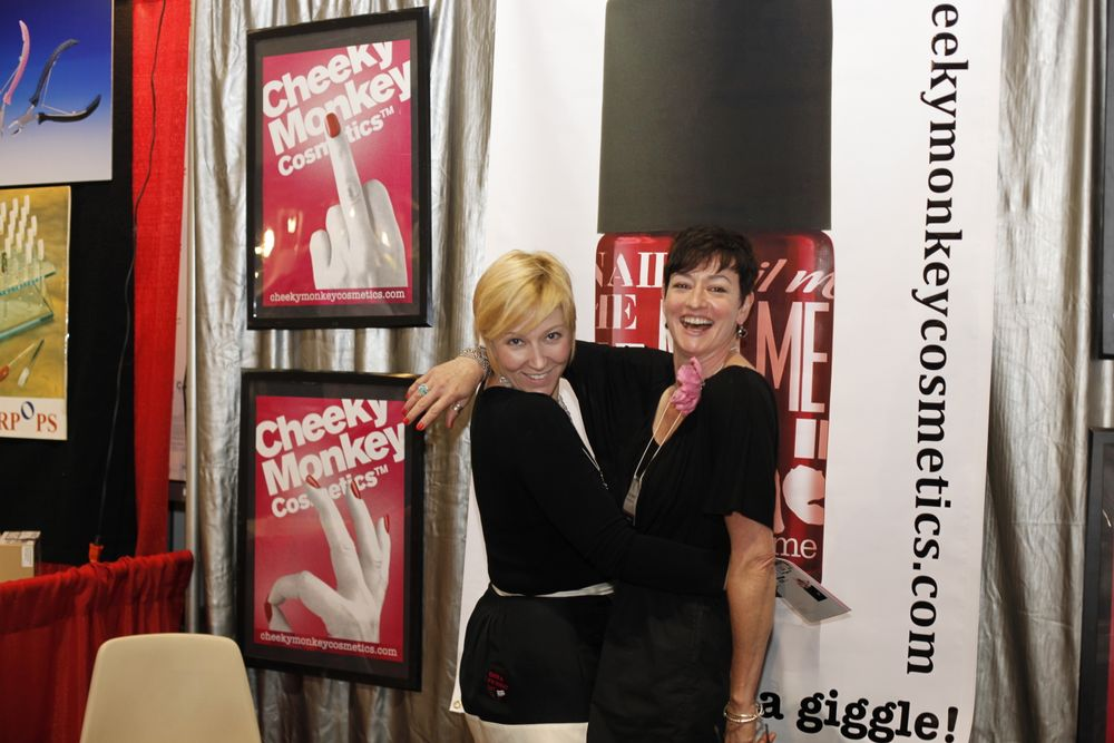 "<p>Cheeky Monkey&rsquo;s Carol Daugherty (left) and Creative Director/Founder Andrea Pahn had fun promoting their new Cheeky Monkey polish colors. Story <a href=""http://blogs.nailsmag.com/editor/archive/2011/06/09/Premiere-Orlando-Cheeky-Monkey-Reminds-You-to-Laugh.aspx"">here</a>.</p>"
