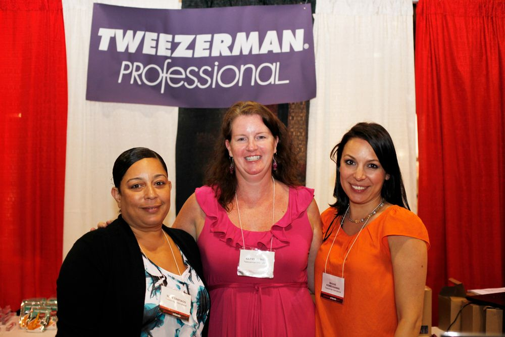 <p>Susie Santiago, Kathy Harvey, and Maggie Kombogiannis greeted attendees at Tweezerman&rsquo;s booth.</p>