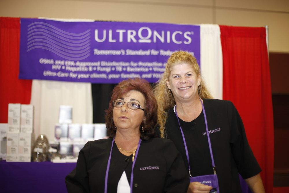<p>Joann Diprete and Jill Phillips greeted attendees at the Ultronics booth. Joann reminds an attendee to properly follow disinfection instructions carefully.</p>