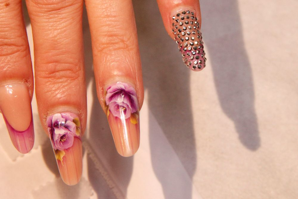 <p>Rose nails by Irma Rossie. Accent nail by Michelle Williams using Pav&eacute; Nail Crystals</p>