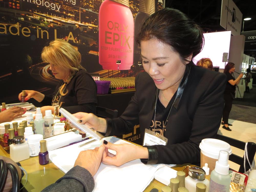 <p>Orly's Elsbeth Schuetz and Ashley Van demo Epix long-lasting nail polish</p>