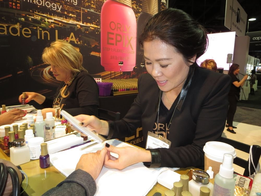 <p>Orly's Elsbeth Schuetz and Ashley Van demo Epix long-lasting nail polish</p>