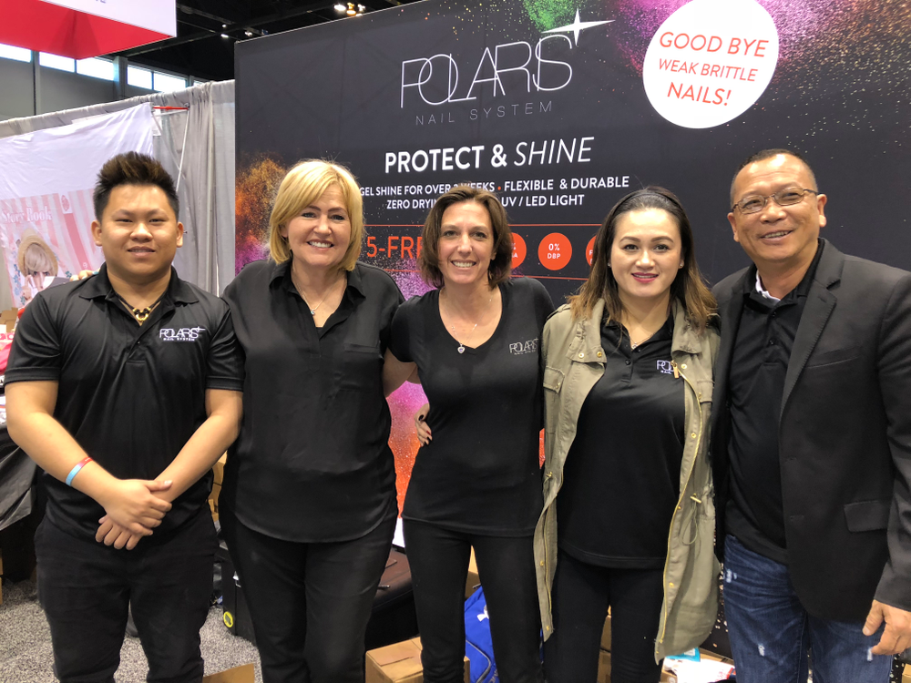 <p>Team Polaris took a break from showing off the brand's color blocking dip powders to take a group photo.</p>