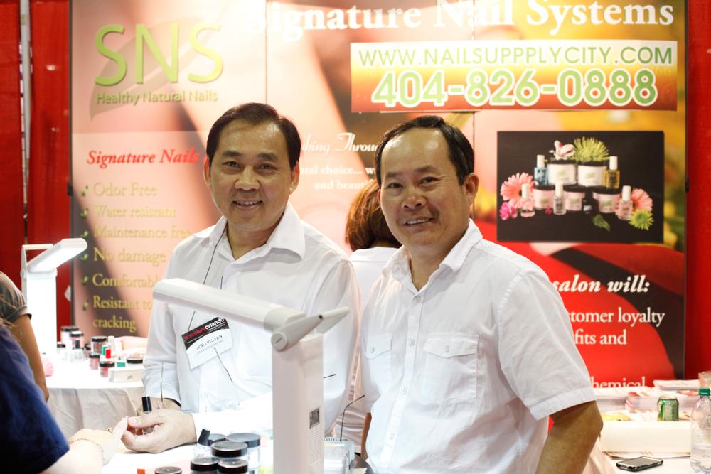 <p>Signature Nail Systems founder Joe Nguyen and Huy Hoang.</p>