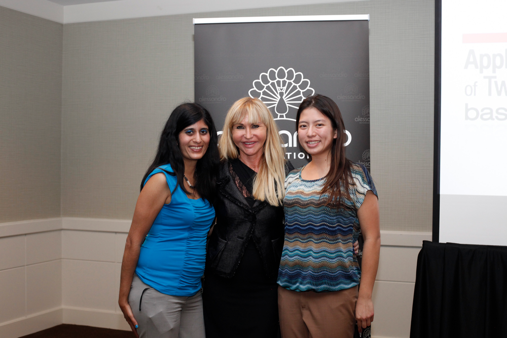 <p>NAILS managing editor Sree Roy and VietSALON associate editor Kim Pham (right) take a photo with Alessandro founder and CEO Sylvia Troska.</p>