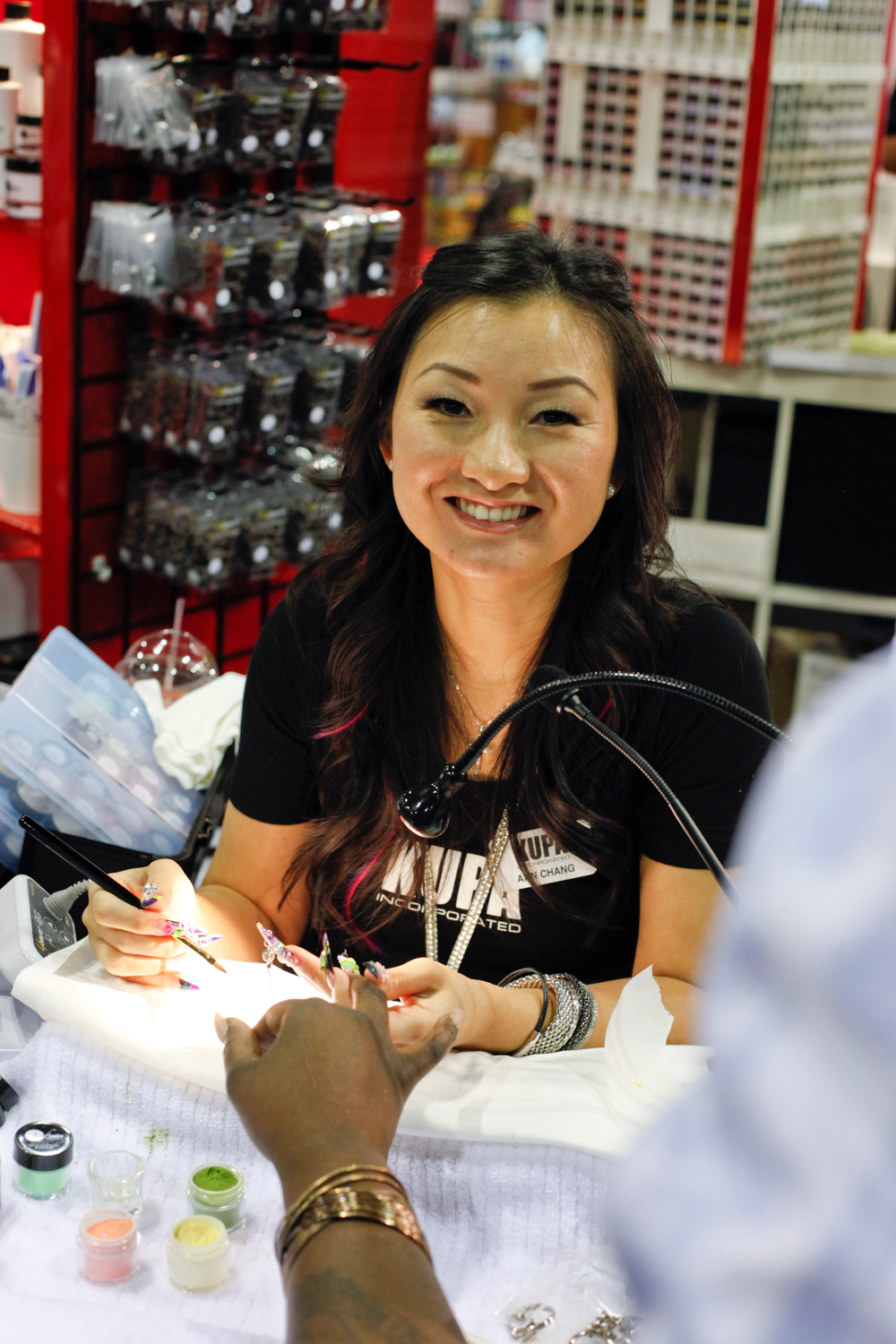<p>Kupa educator Ann Chang stayed busy during the show creating 3-D acrylic flowers and enhancements.</p>