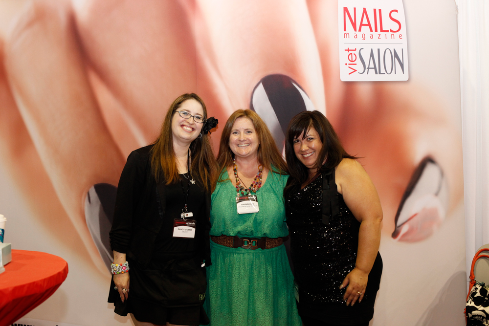<p>Gelish&rsquo;s Sandy Borges and MaeLing Parrish visited Hannah Lee (center) at the NAILS booth.</p>