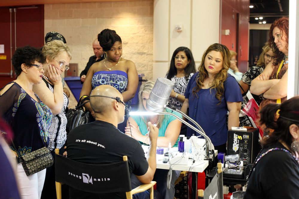<p>Young Nails&rsquo; Greg Salo shows his technical mastery on the Young Nails nail trainer to a crowd of attendees.</p>