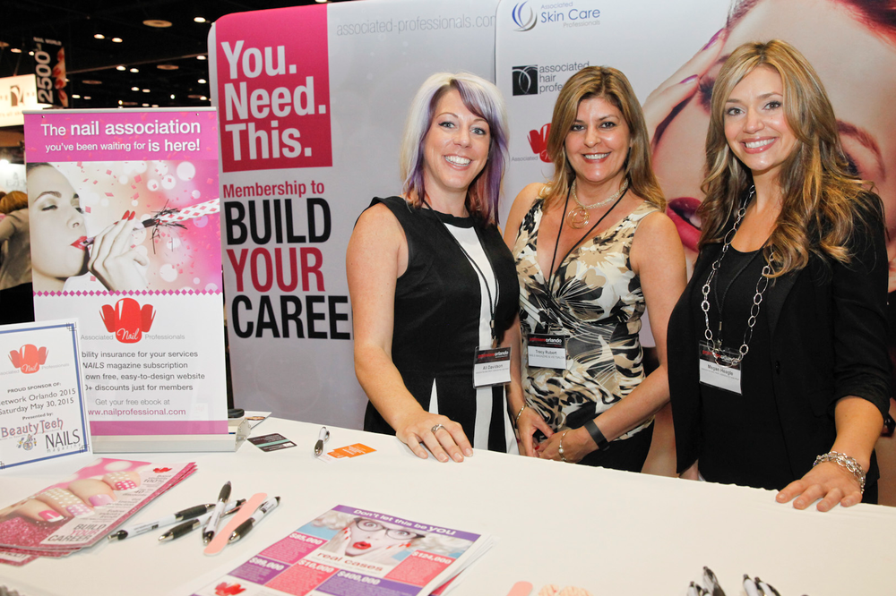<p>NAILS senior editor Tracy Rubert (center) with The Nail Association&rsquo;s Ali Davidson and Megan Heagle</p>