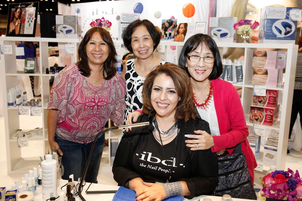 <p>Hong Nguyen, Mai Pham, and Giang Lombard with IBD's Terry Burciaga.</p>