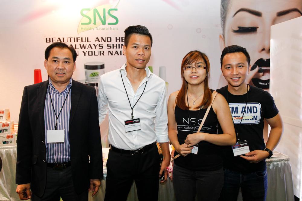 <p>Signature Nail Systems (SNS) founder Joe Nguyen with Nail Supply City&rsquo;s Nghi Ngo, Quynh Dang, and Tuan Tran</p>