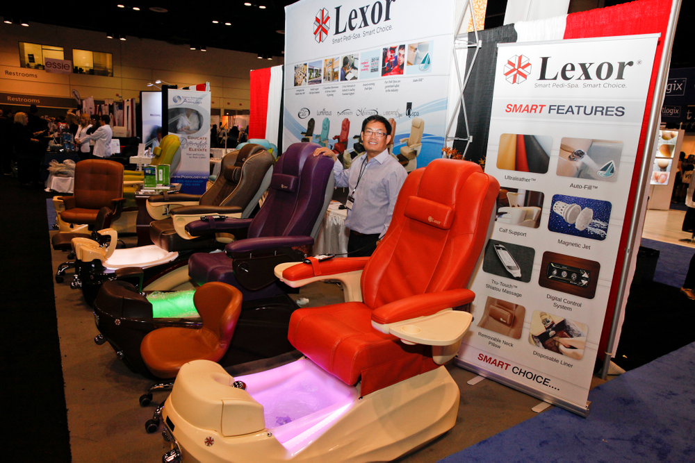 <p>Chris Luong with Lexor&rsquo;s Luminous (left) and Mystique pedicure spa chairs integrated with the company&rsquo;s newest Aurora LED Color-Changing Bowls.</p>
