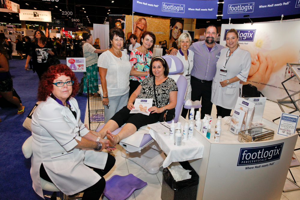 <p>Footlogix&rsquo;s Linda Prida demos some of the company&rsquo;s comprehensive pedicure products for show attendees Sandra Montiel, Yvonne Rodriguez, and Carrie Rose from Carrie&rsquo;s Hair &amp; Nails in Tampa, Fla. surrounded by Debra Bourque, Keith Grader, and Tanya Palladina</p>