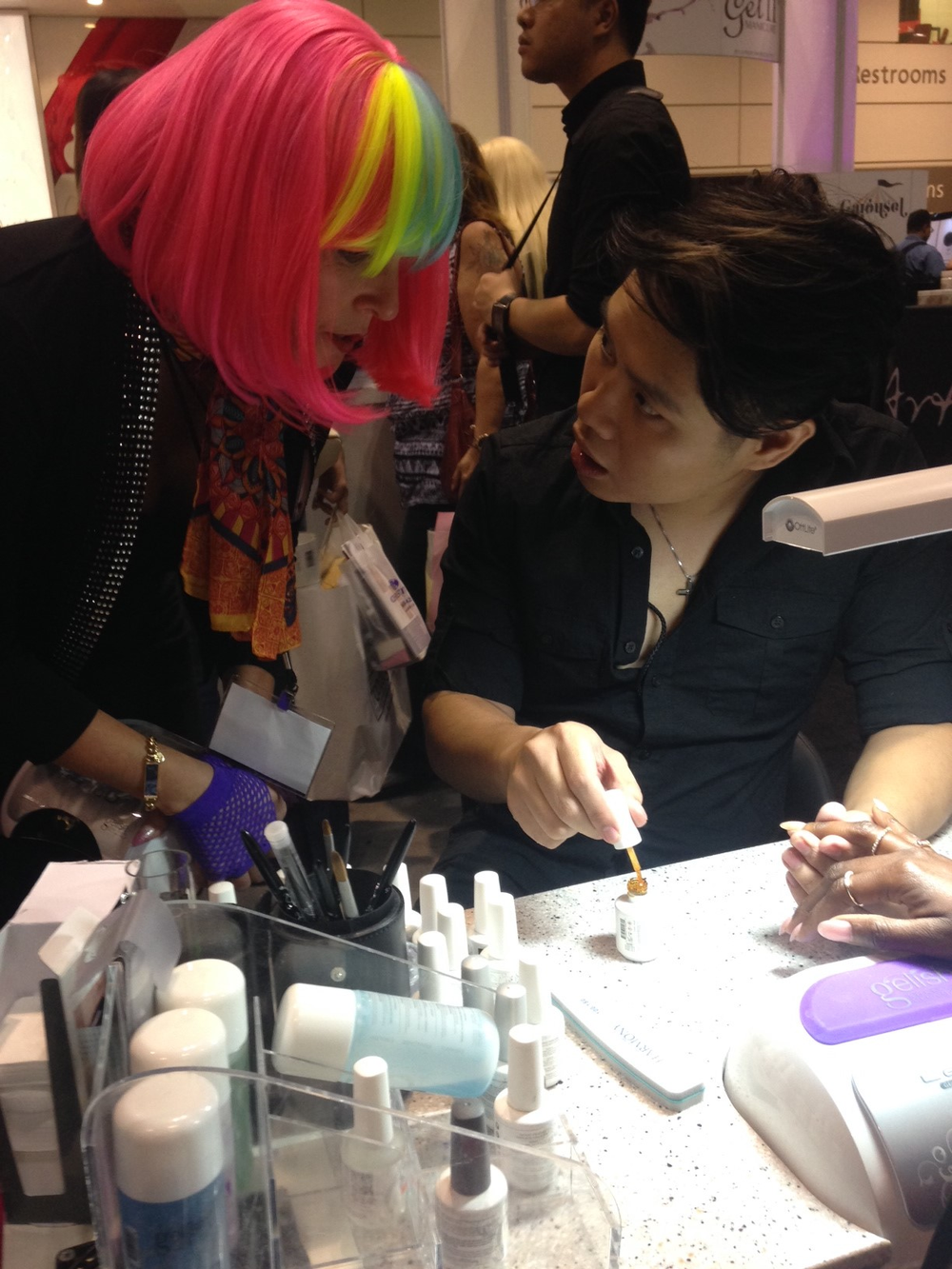 <p>Live demos at the Gelish booth by Bryan Vu</p>