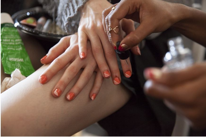 <p>Lead manicurist Rica Romain shaped short, round nails and used a toothpick to create the lines. Photo courtesy of Red Carpet Manicure.&nbsp;</p>