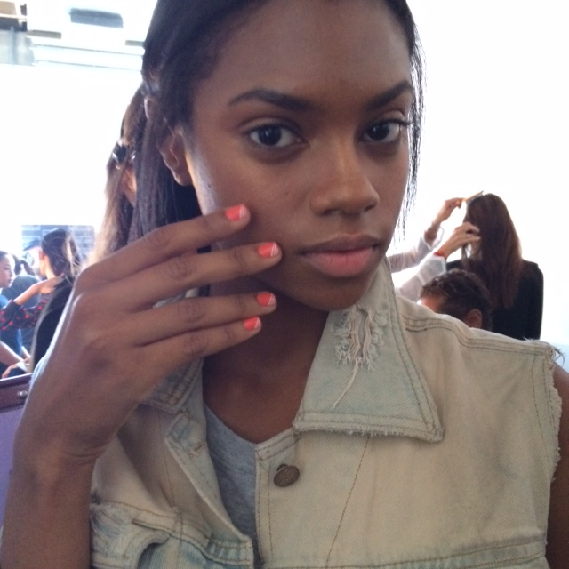 <p>At the Meden Show, models walked the runway wearing Red Carpet Manicure White Hot and Flirt Alert. Designs alternated between a white base with three stripes of Flirt Alert and Flirt Alert as a base with three stripes of White Hot. Photo courtesy of Red Carpet Manicure.&nbsp;</p>