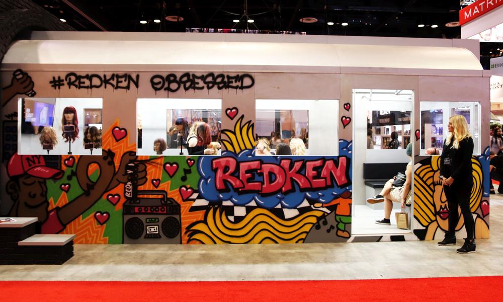 <p>The Redken booth had stylish graffiti</p>