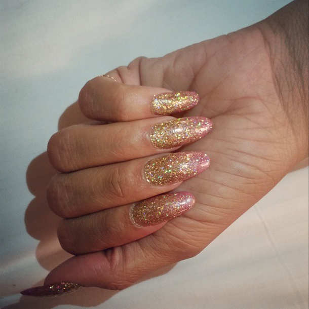 "<p>Red Carpet Manicure's My Favorite Designer and gold glitter were used by Kimmie Kyees to cap off Rihanna's nail look. Image via <a href=""https://instagram.com/kimmiekyees/"">@kimmiekyees </a></p>"