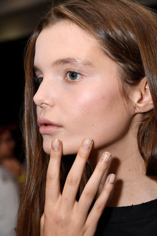 <p>Nail lead Tracylee used Morgan Taylor New School Nude and Glitter &amp; Gold for Rodarte.</p> <p>Photo credit: Courtesy of Morgan Taylor Lacquer</p>