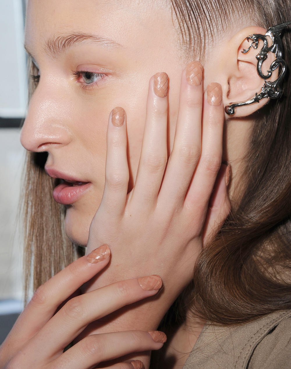 <p>These &ldquo;modern medieval&rdquo; manicures were custom-made by <strong>CND </strong>with a blended peach base and strips of polish hand-woven into the nail for a play on texture and finish.</p> <p><em>Photo courtesy of CND</em></p>