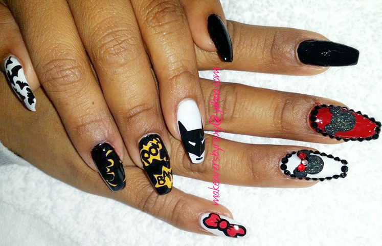 <p>Batman meets Hello Kitty meets Mickey, and Minnie Mouse, nails by Roxy Carillo</p>