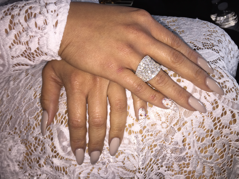 <p>OITNB star Dascha Polanco wore Essie Sand Tropez and hand-painted lace nail art with Swarovski crystals to match her dress at the SAG awards. Image courtesy of @mrluisnails.</p>