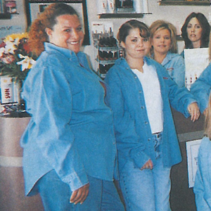 Awesome Nails owner Mary Metscaviz (bottom row, seated) says she and her staff are so close they...