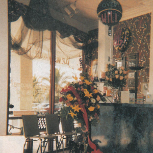 Blue marbleized Formica and flowers, along with an ever-chaging display of knick-knacks and...