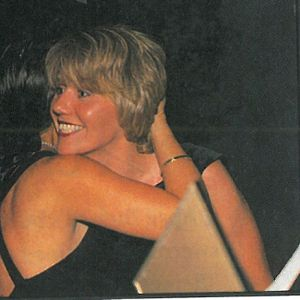 Debra Shoaff gets a hug from NAILS Shows competition director Sharon Parker when her name was...