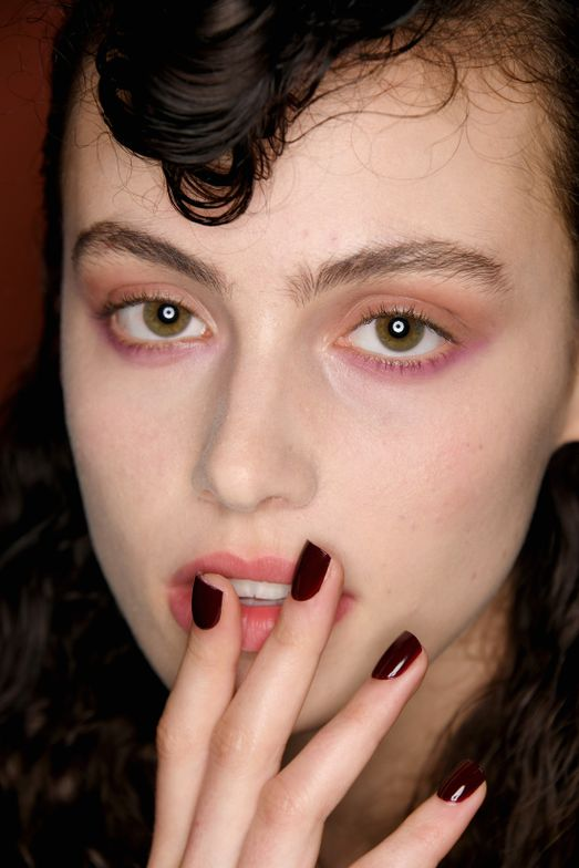<p>Inspired by the Self-Portrait woman's poised and playful individuality, Morgan Taylor Lacquer lead artist Gina Edwards created three manicures. This look features From Paris With Love, an alluring oxblood red.</p>
