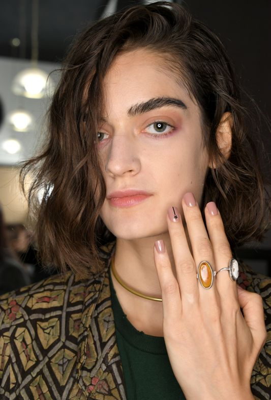 <p>This look adds a playful exclamation,using Little Black Dress to create a black shooting star centered near the cuticle.</p>