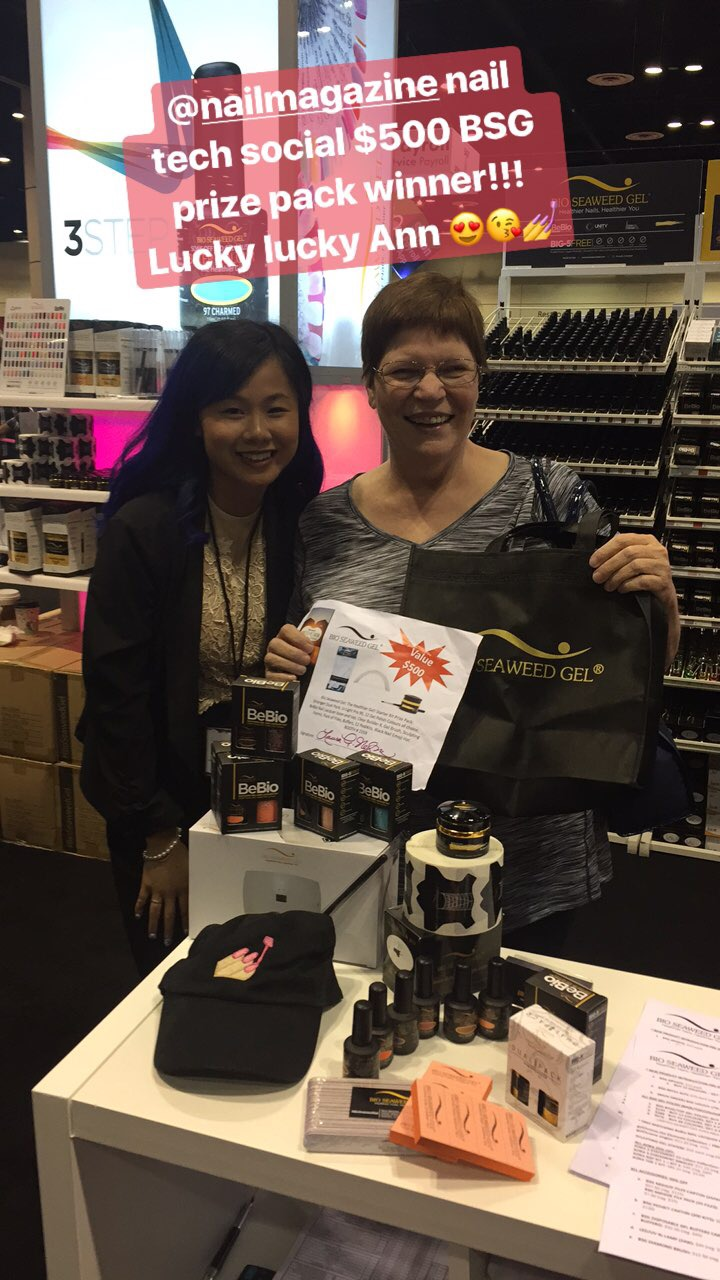<p>Bio Seaweed Gel's raffle prize winner picking up her goods at the booth!</p>