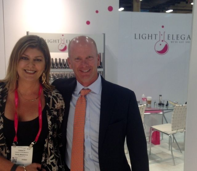 <p>NAILS managing editor Tracy Rubert and Light Elegance's Jim McConnell</p>
