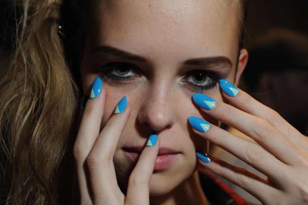 <p><strong>Sally Hansen</strong> collaborated with Tracy Reese for the 14th consecutive season. A unique triangular half-moon manicure featuring four different combinations fit right in for Reese&rsquo;s colorful show. Combinations used on the runway included: Soy Latte/Butterscotch, Naked Ambition/Midnight in NY, Blue Me Away/Mint Sorbet, and Kook-A-Mango/Butterscotch.</p>